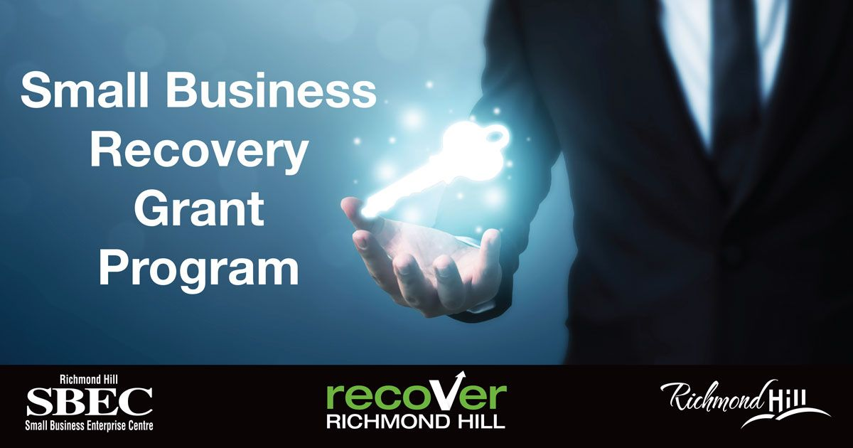 Photo of a person holding a key for the Small Business Recovery Grant program administered by SBEC Richmond Hill, Recover Richmond Hill and City of Richmond Hill